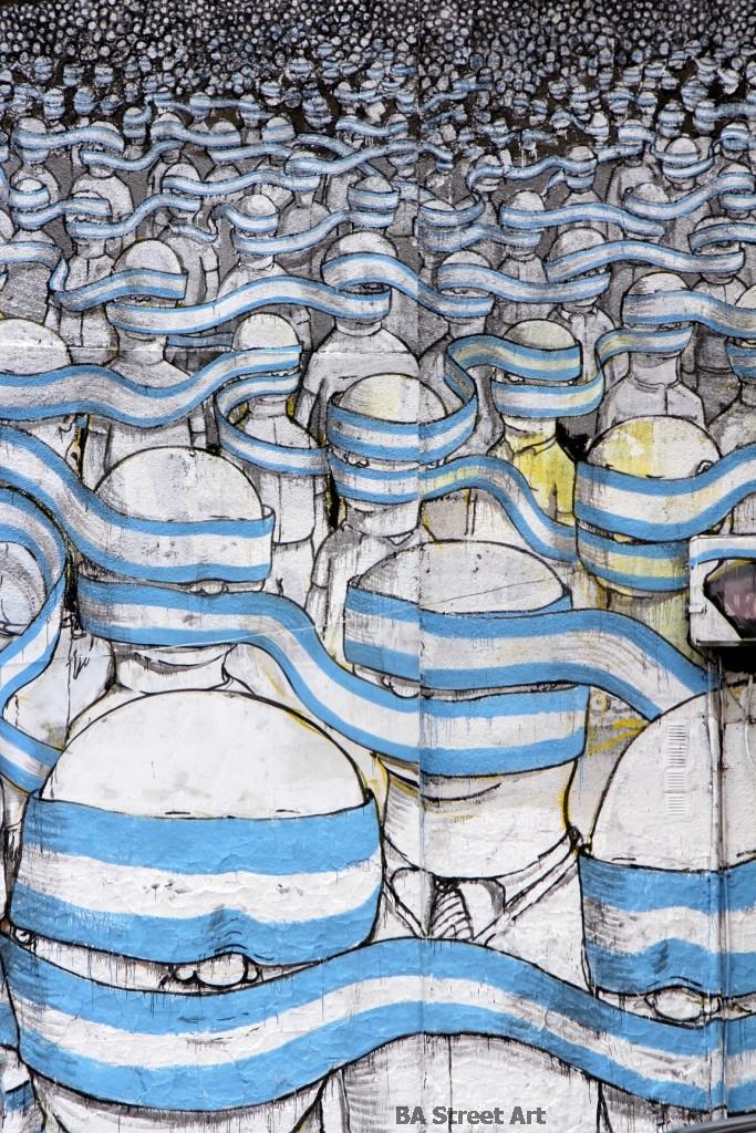 blu graffiti buenos aires blindfold flag argentina murales street art tour buenosairesstreetart.com