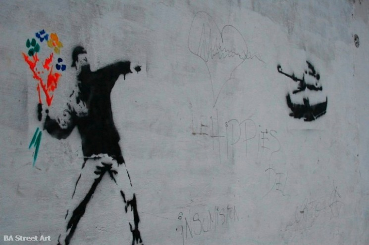 Banksy Love is in the air flower thrower graffiti buenos aires tour © BA Street Art stencil buenosairesstreetart.com