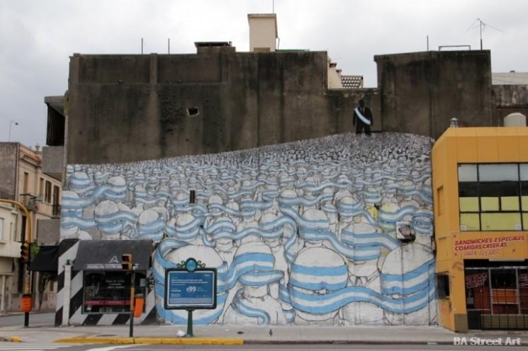 Blu buenos aires mural flag blindfold political graffiti street art tour © BA Street Art buenosairesstreetart.com