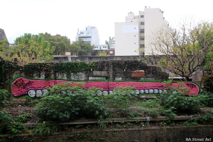 teeth graffiti artist argentina buenos aires street art buenosairesstreetart.com