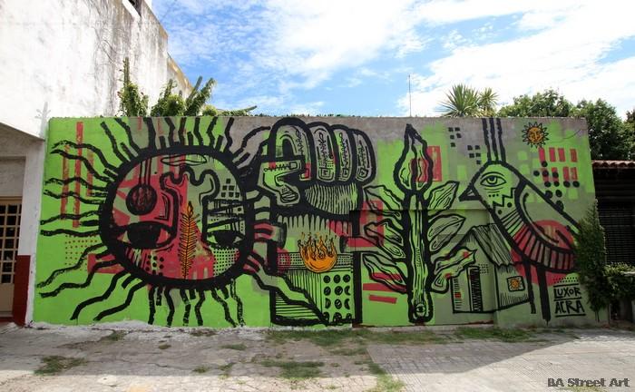 urban art buenos aires sun flower fist mural argentina buenosairesstreetart.com