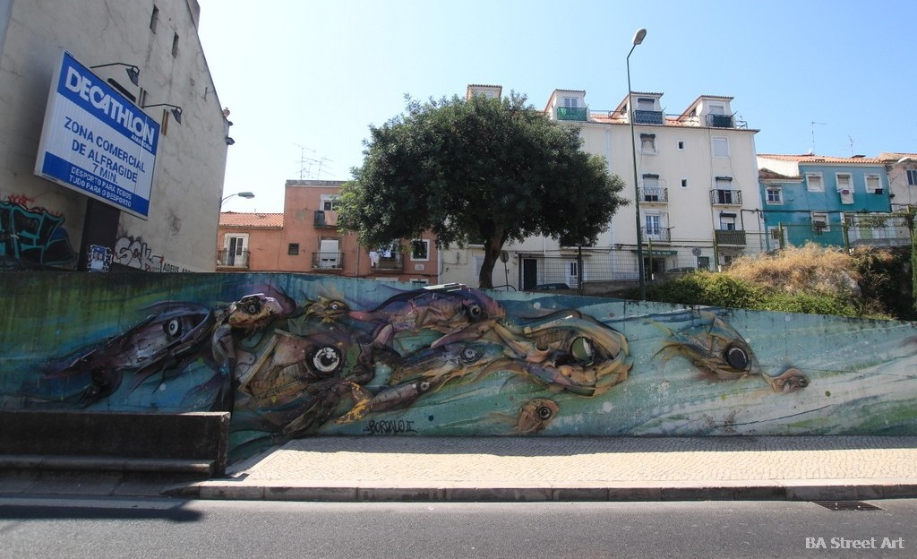 alcantara station lisbon portugal bordalo II trash peixe sculpture lisbon portugal mural LX factory guaxinim lisboa graffiti tour pez escultura murais rubbish recycled material