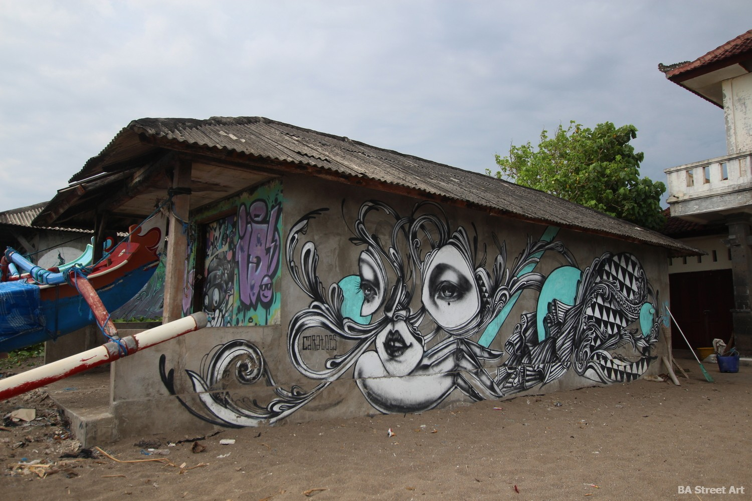 nelayan beach canggu bali sand waves sea fisherman shack hut graffiti street art mural buenosairesstreetart.com