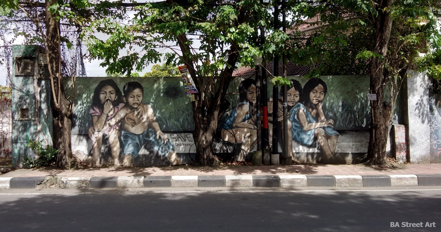 peanut dog mural children girls bus stop indonesia bali ubud artist buenosairesstreetart.com