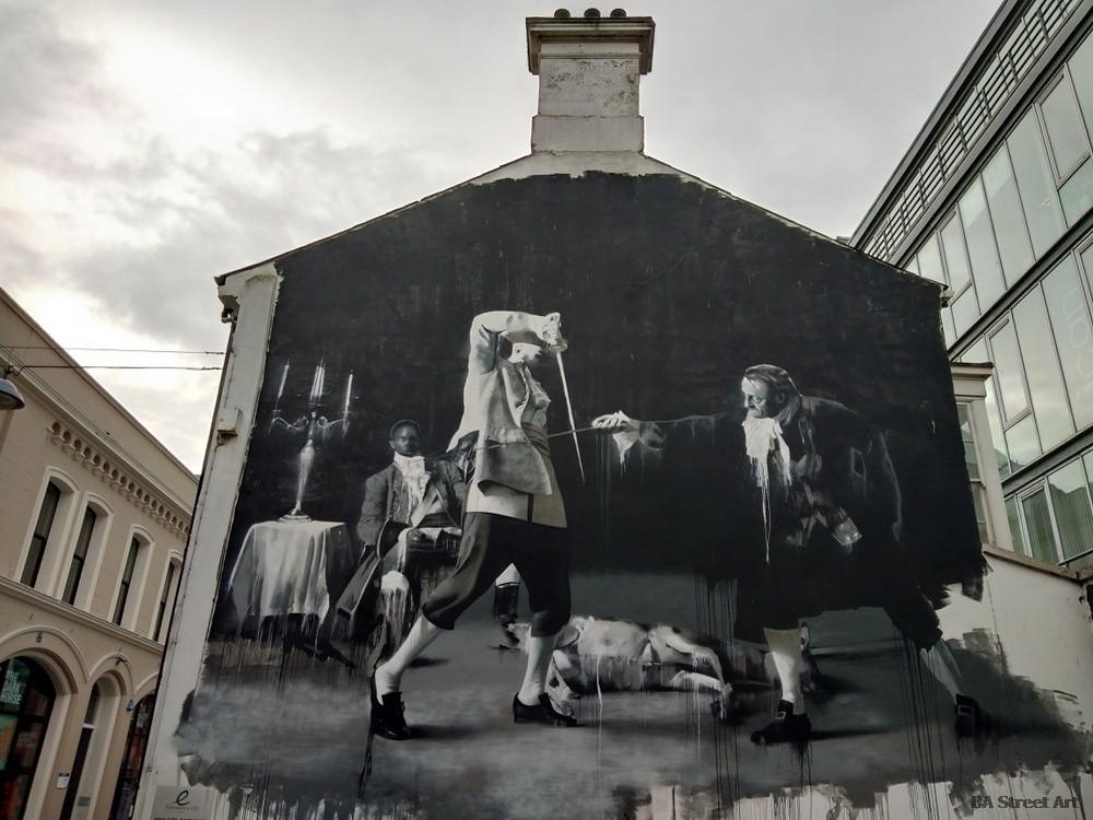 conor harrington mural belfast street art tour duel swords northern ireland irish artist black white
