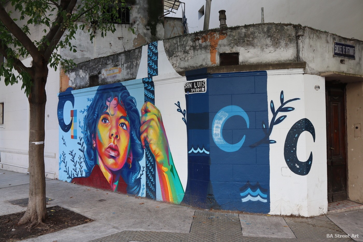 murales buenos aires arte callejero argentina thomas evans detour moon luna lucia portrait buenosairesstreetart.com